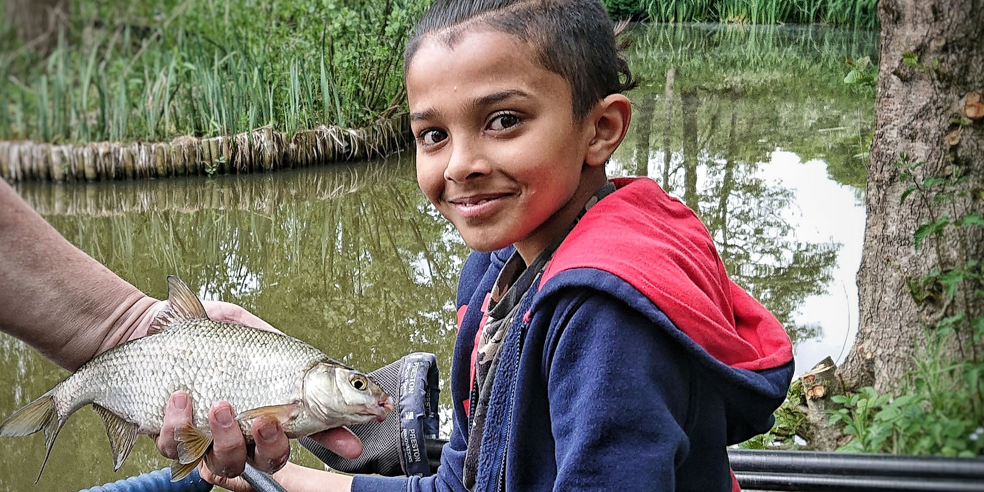 Girl fishing with a skimmer bream
