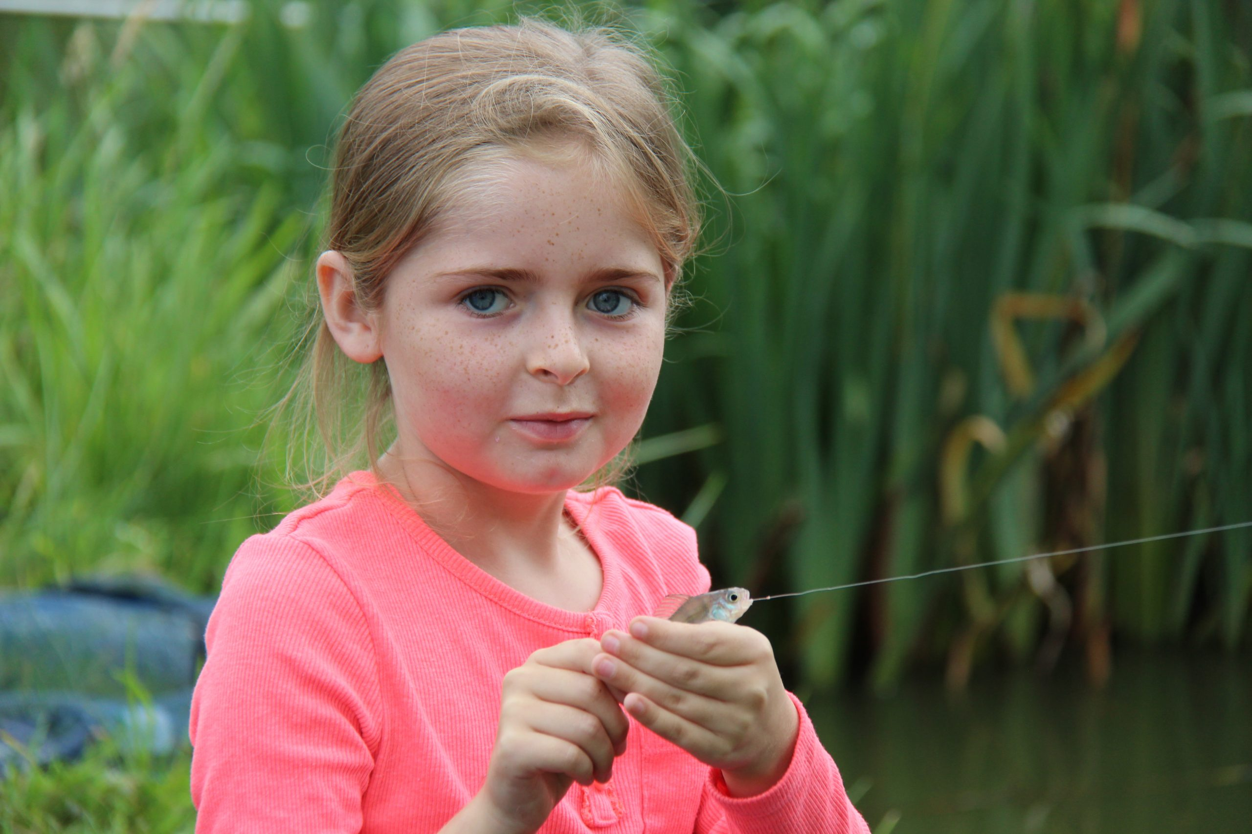 Get Fishing - a young girl with a fish