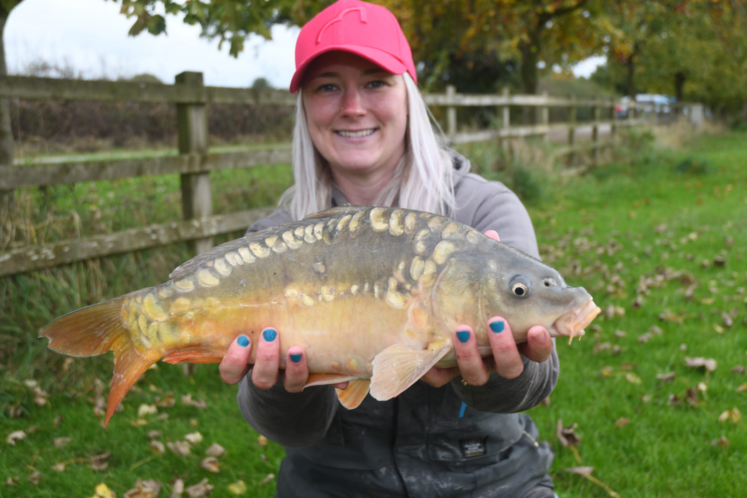 Get Fishing - Emma Harrison Fishing with a carp at a commercial fishery-3