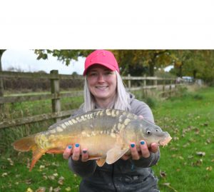 Get Fishing - Emma Harrison Fishing with a carp at a commercial fishery-7