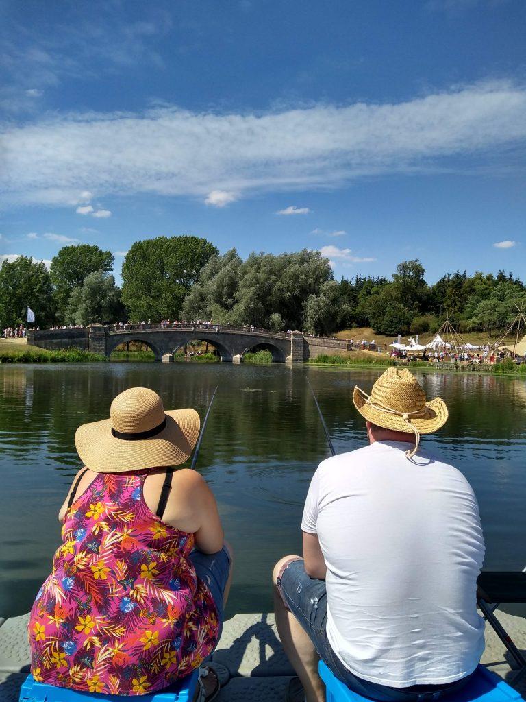 Get Fishing | Take a Friend Fishing - 2 people fishing by water